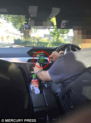 Horrified Uber passenger 'photographs his driver playing Pokemon Go DURING their journey across London'