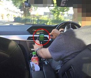 Horrified Uber passenger 'photographs his driver playing Pokemon Go DURING their journey across London'